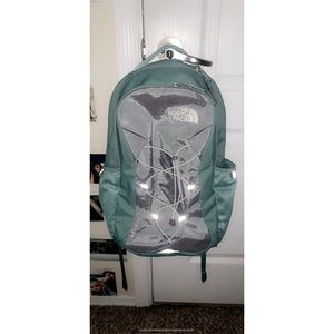 North Face silver & teal backpack.